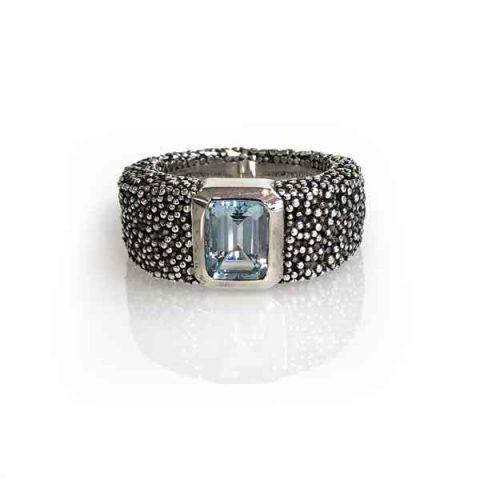 ring grain of earth silver oxidised stone blue topaz