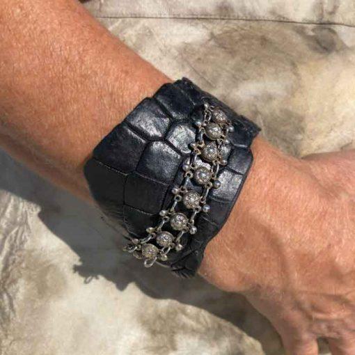Model wearing crocodile bracelet with silver chain