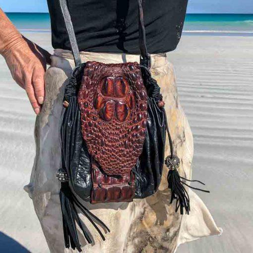 model wearing crocodile handbag